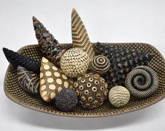 Oval Bowl filled with Ceramic Rattles