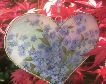 Iridescent light blue stained glass heart.