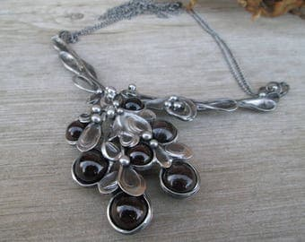 metal necklace with garnet