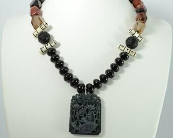 Black fish carved jade pendant necklace