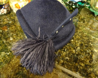Navy blue vintage 100% wool cloche hat, size 22, with tassel and bow decoration and netting