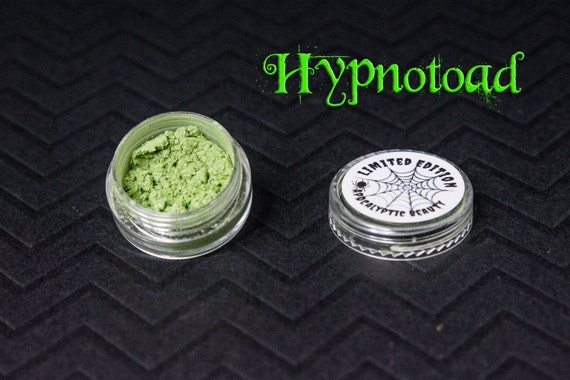 Hypnotoad - Limited Edition vegan green eyeshadow with orange duochrome and violet sparks
