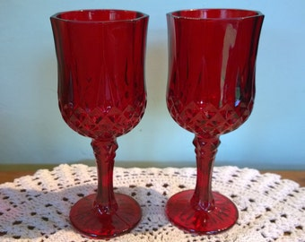 A pair of vintage red angular wine glasses cranberry ruby