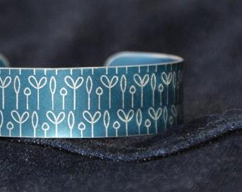 Spring buds pattern cuff bracelet dark blue