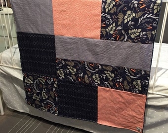 Baby blanket ,navy foliage, coral pattern.