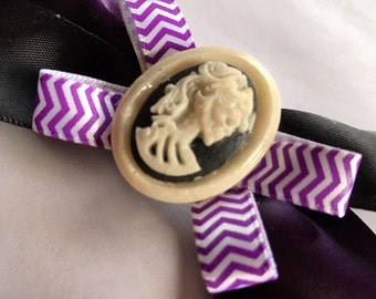 Purple and black hair bow with  ameo skeleton.
