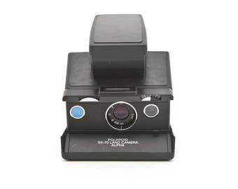 Polaroid SX-70 Alpha with New black Leather Covering - Film Tested - Guaranteed Working
