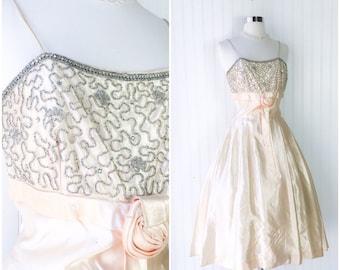 vintage 1950s champagne satin rhinestone beaded cocktail wedding tea length dress //  empire waist rosette sash full skirt // size S