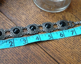Costume Silvertone bracelet with faceted black stones