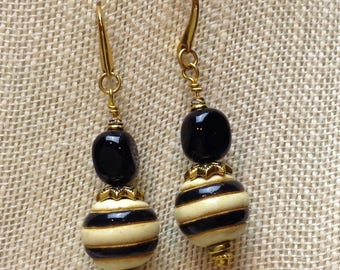 REDUCED: Golem bead earrings topped with black onyx is stunning with its ivory and black stripes.