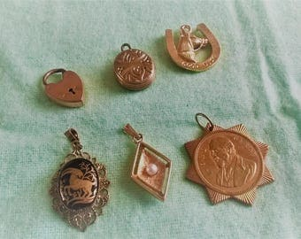 Selection of pendants - unusual collection - horseshoe, zodiac, locket and heart clasp