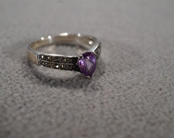 vintage sterling silver solitaire ring with pear shaped amethyst set in a band with marcasite accents, size 8  M2
