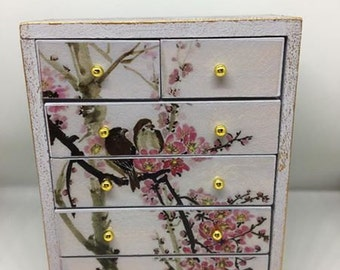 Handmade miniature dolls house furniture. Shabby chic style chest of drawers with bird decals
