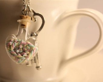 Marshmallow in a heart shaped bottle necklace handmade