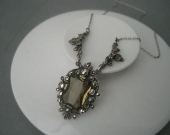 Elegant Art Deco solid silver necklace with marcasites and a brown/green stone.