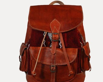Rugged brown leather and cotton backpack woven boho/hippie-chic style