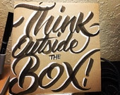 Think outside the Box (hand lettered motivational card)
