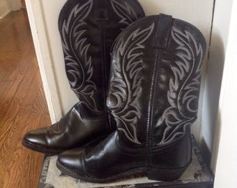 Pair of Vintage Cowboy boots...Laredo Brand...Black with white stitching....Womans
