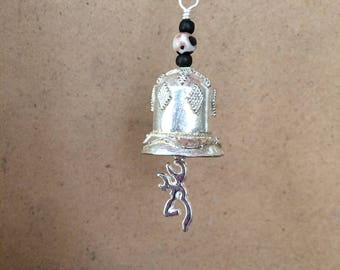 Unique and different ornate silver motorcycle bell with pewter browning deer charm and brown   accents.