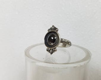 This ring is a size 7 1/2 with an 8 mm Hematite . New style.