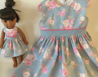 Daughter and doll matching dresses