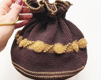 1930's brown crochet pouch purse with gold highlights and brass beading.