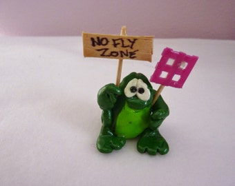 """Frogs in Control - Mini Clay Creation Frog 2 1/2"""" tall, 1 1/2"""" wide with fly swatter and sign - also free shipping"""