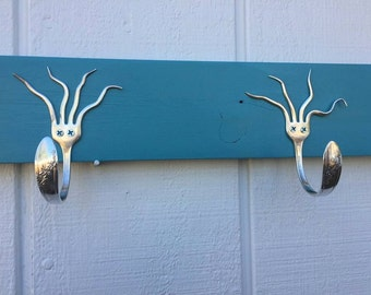 Bent Fork Hanger. Turquoise painted pallet wood. Made with 1946 Queen Bess pattern, Silver Plate