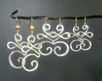 New Beginning earrings. New beginning symbol celebrates a new start!