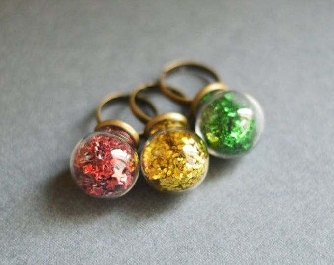 GLITTER The dimensionless ring of metal brass with a sphere of glass, Red, Yellow, Green, Glamour