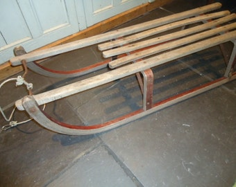 Vintage bentwood wooden sledge with metal runners