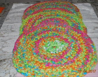 Set of 4  hand crocheted cotton summer placemats 12+ inches diameter, bright pink, green, yellow and blue