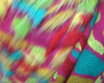 Luxurious multi color faux fur fuschia aqua yellow. Sold By The Yard