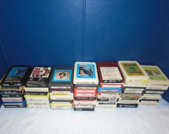 Assorted 8 track tapes. 8 track tapes. 8 track tape. eight track tapes. recorded music. old 8 track tapes.