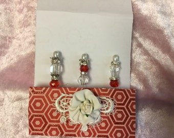 "White and red decorative stick pins. 2"".  3pack. Comes with decorative holder."