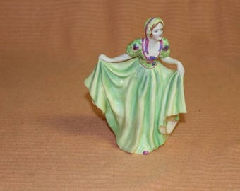 "8""tall Green Ceramic figurine Made in England no makers mark"