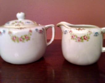 nippon handpainted individual sugar with  lid and creamer