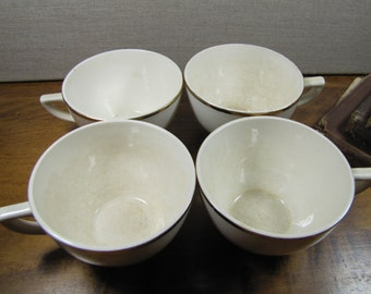 Set of Four (4) Creamy White Teacups - Gold Accent Rim - USA