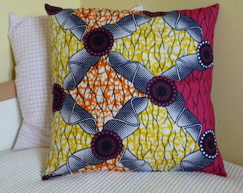 Square cushion cover - Wax pink, yellow and orange.
