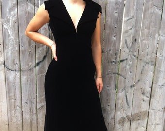 Late 70's long black velvet sleeveless evening dress with deep V neckline, empire waist and wide tailored collar.