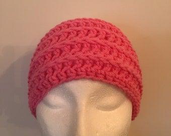Hand crochet pink headband.