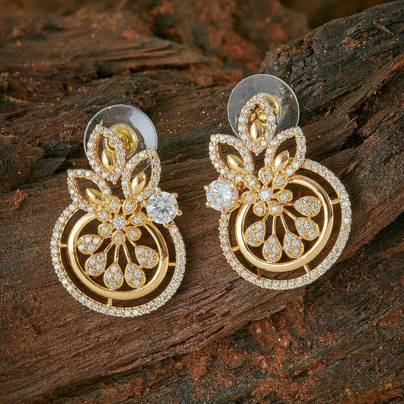 Contemporary earrings in a flower shape with Cubic Zirconia detailing | Indian Jewelry | Indian Earrings | Gold Plated