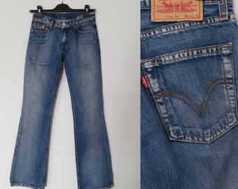 Levis 529 jeans, low rise hipster, flared bootleg, blue denim pants trousers, waist 24, leg 32, x small