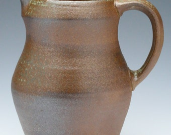 Woodfired, ash glazed ceramic pitcher