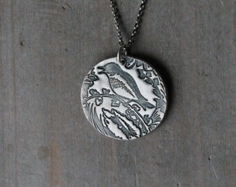 Bird and flowers fine silver pendant