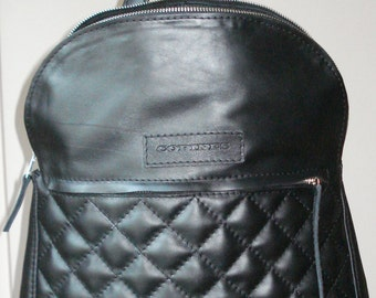 Leather black backpack zippered.