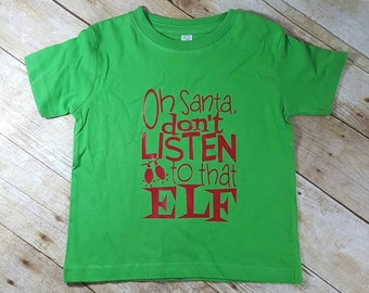 Oh Santa Don't listen to that Elf funny christmas Holiday Toddler Shirt