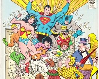 Super Friends 1 comic. Justice League, Poison Ivy, Wonder Woman, Superman, Batman and Robin. Childrens TV Show. 1976 DC Comics in VFNM (9.0)