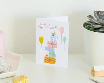 Carte Anniversaire - Petit chat mignon avec cadeaux et ballons