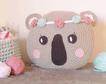 Crochet koala-faced pad with flowers for children made by hand